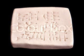 Assyrian tablet with cuneiform characters (on black background)