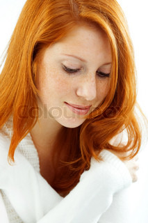 Photo of beautiful female with red hair and freckled skin on her face