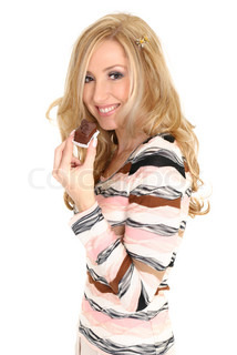 A smiling blonde woman holds a delicious chocolate truffle in her hand