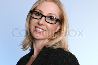 Friendly businesswoman wearing pinstripe suit and wearing glasses on a graduated blue background
