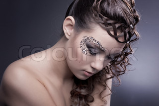 Beautiful woman with fashion makeup and ancient hairstyle