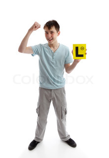 A teen boy holding his L plates (learner driving plates) and showing a fist of successWhite background Or, plates maybe replaced with your brochure or other object