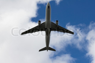 A commercial jet plane flying over