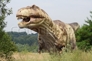 t-rex attacking from big grass