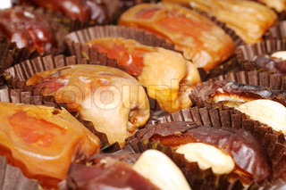 Dried dates fruits with nuts , close up