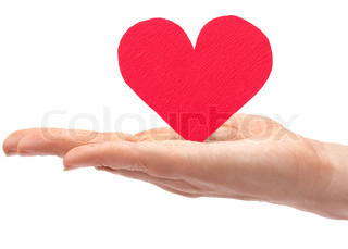 Red paper heart in hand