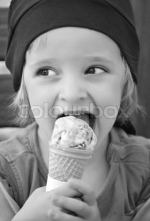 The little girl eating an ice cream