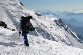 Alpine climbing Climber with backpack and ice-axe
