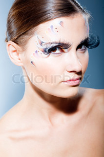Fashion make-up with face art and extra long lashes