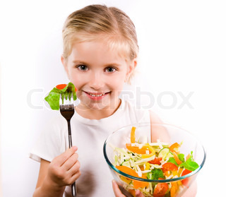 Little girl eating vegetable salad - healthy food concept