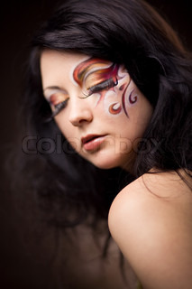 Fashion make-up with long lashes and face art on beautiful model Shallow DOF, focus on left eye