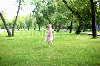 Portrait of a little girl running in the park