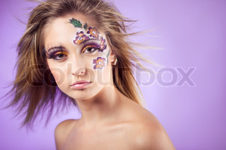 Flower face art and colorful eye makeup