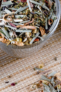 high quality herbal tea in glass closeup on straw background