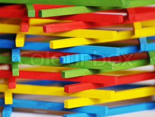 The blue, red, green and yellow wooden sticks