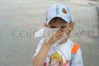 child wipes face