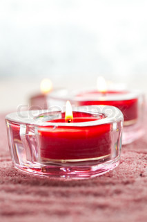 Close-up of valentine candles on pink sand