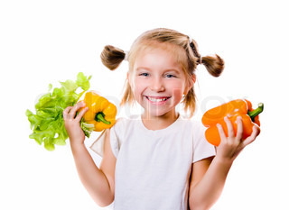 Little girl with the vegetables- healthy food concept
