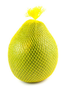 Pomelo fruit wrapped in a yellow plastic isolated on white