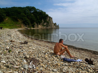 naked man on the wild beach