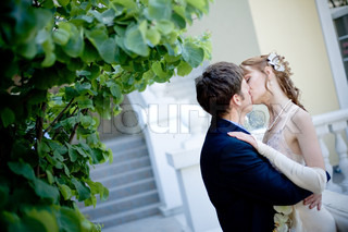 Kissing bride and groom