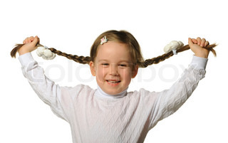 The little girl holds hands braids It is isolated on a white background