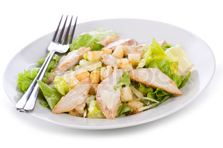 Caesar Salad with chicken on a white background