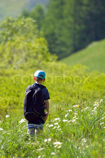 A young child walking in the meadow