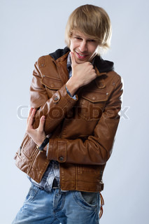 Handsome young man in leather jacket, studio portrait
