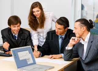 Photo of office workers having a discussion