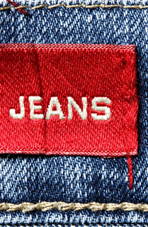 Blue jeans and red label with word Jeans