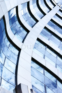 Abstract architectural background with building and sky reflction in the windows