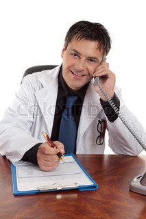 Cheerful smiling doctor taking a telephone call