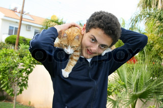 Teen and cat on his shoulders