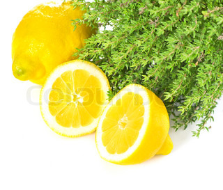 close-up of thyme herb and lemon fruits isolated on white backgroun
