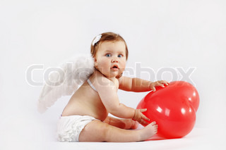 Cute valentine angel baby with red heart on light studio background