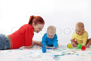 Two babies painting with mother