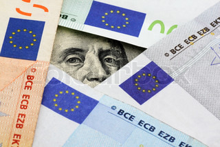 euro vs dollars: Franklin stare through space between euro banknotes