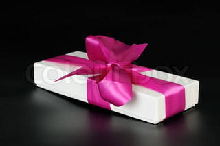 Gift box with a big pink bow