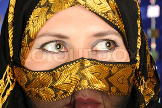Close up picture of a Muslim woman cower face with a veil