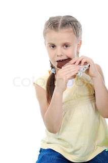 Little girl eating chocolate Isolated on white background