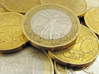 heap of euro coins: one euro with Vitruvian man image  is on the top