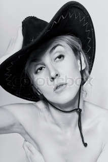 Naked women with cowboy hat on light background