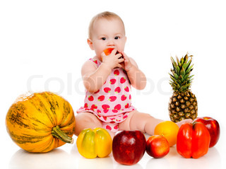child with vegetables and fruits on white