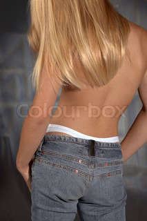 a young girl with long blond hair and naked upper part of the bodyStudio shot from behind in abstract back