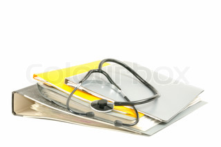 Medical stethoscope with file folders on a white background