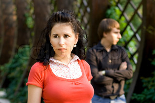 outdoor portrait of unhappy young couple