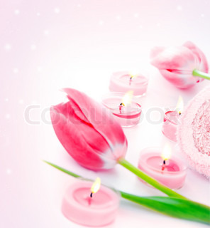 Spa candle with pink tulip flowers, aromatherapy day spa salon, relaxation and beauty treatment concept, objects over pink glitter shiny background