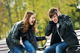 conflict in young people relationship Furious anger girl and man stopped ears with hands