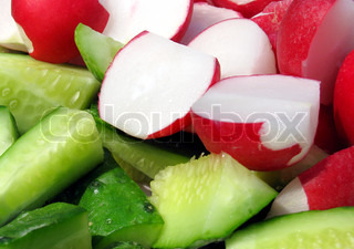 fresh cutted vegetables: cucumbers and radish